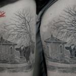 Tattoo con paesaggio in provincia di Parma con mucca - Guarito